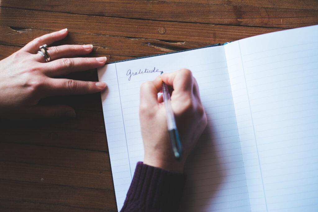 woman journaling gratitude