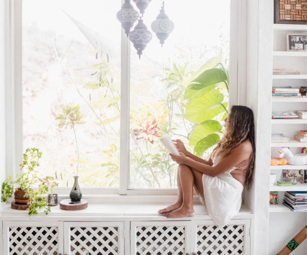 woman sitting in the windowsill