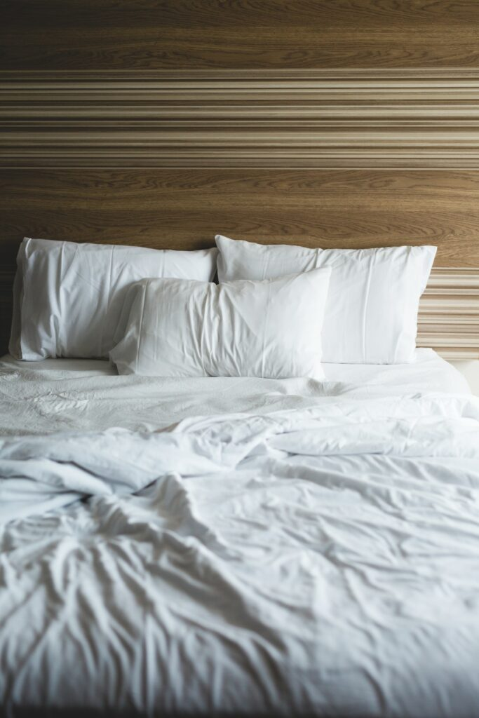 empty bed with sheets
