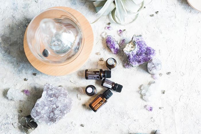 essential oils with crystals and a diffuser