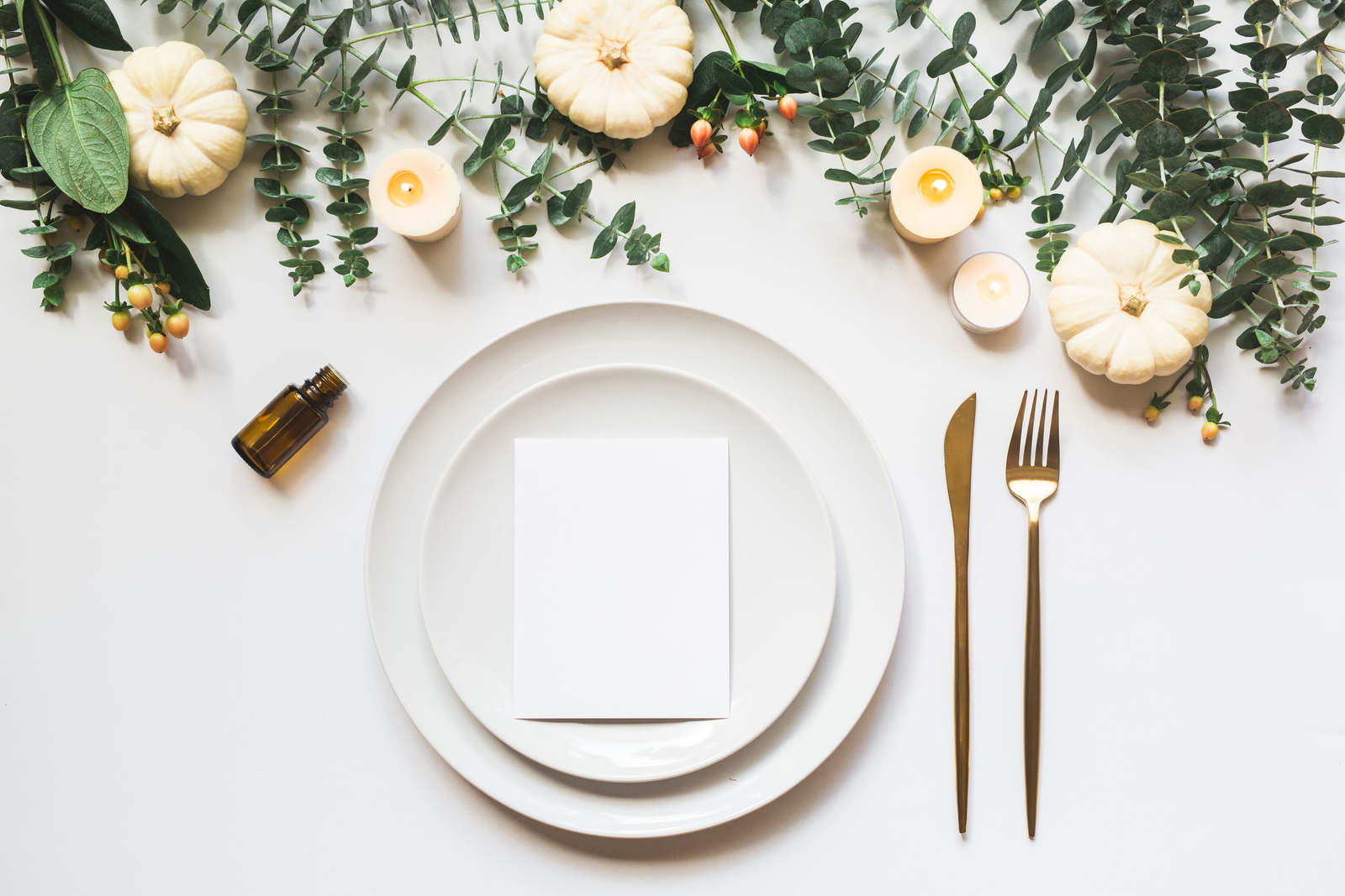 thanksgiving place setting with empty essential oil bottle