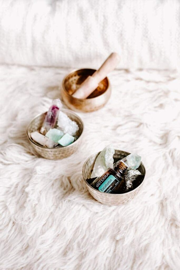 essential oils with crystals on a sheepskin rug
