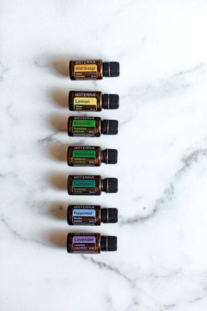 stack of essential oils on a marble counter top