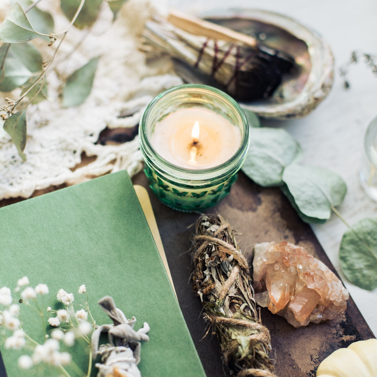 candle burning with sage