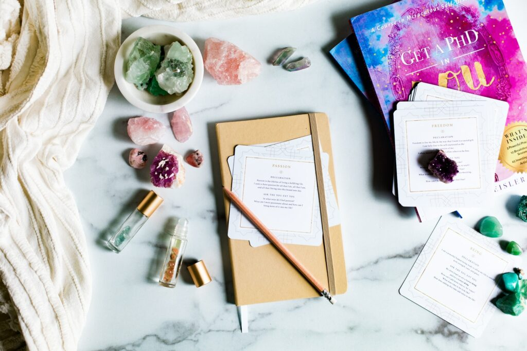 journal with helaing crystals and essential oils