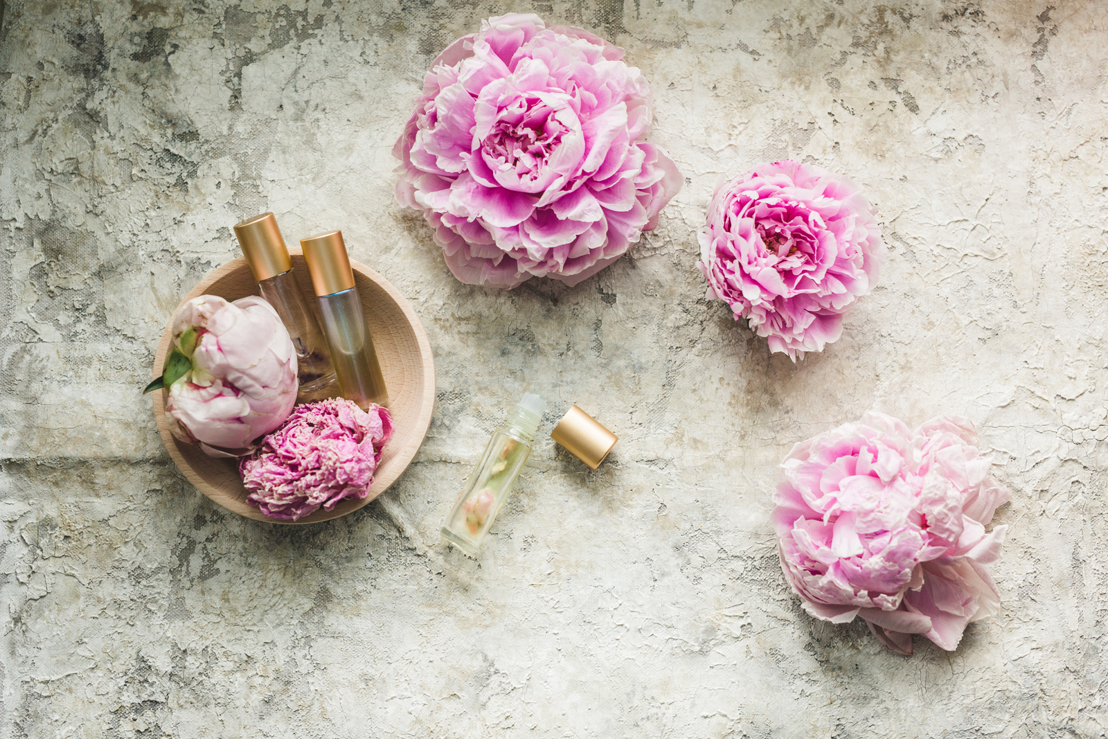 essential oils and pink flowers