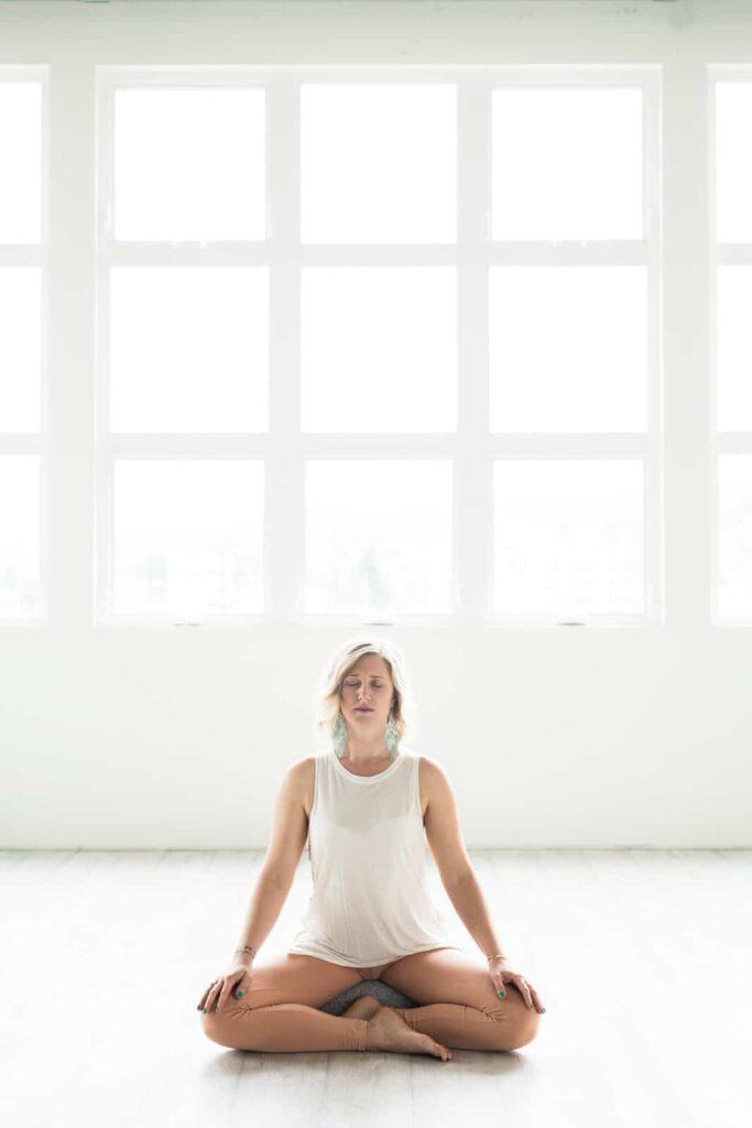 woman meditating in wellness studio
