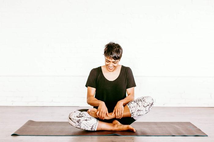 woman in black tshirt practicing yoga