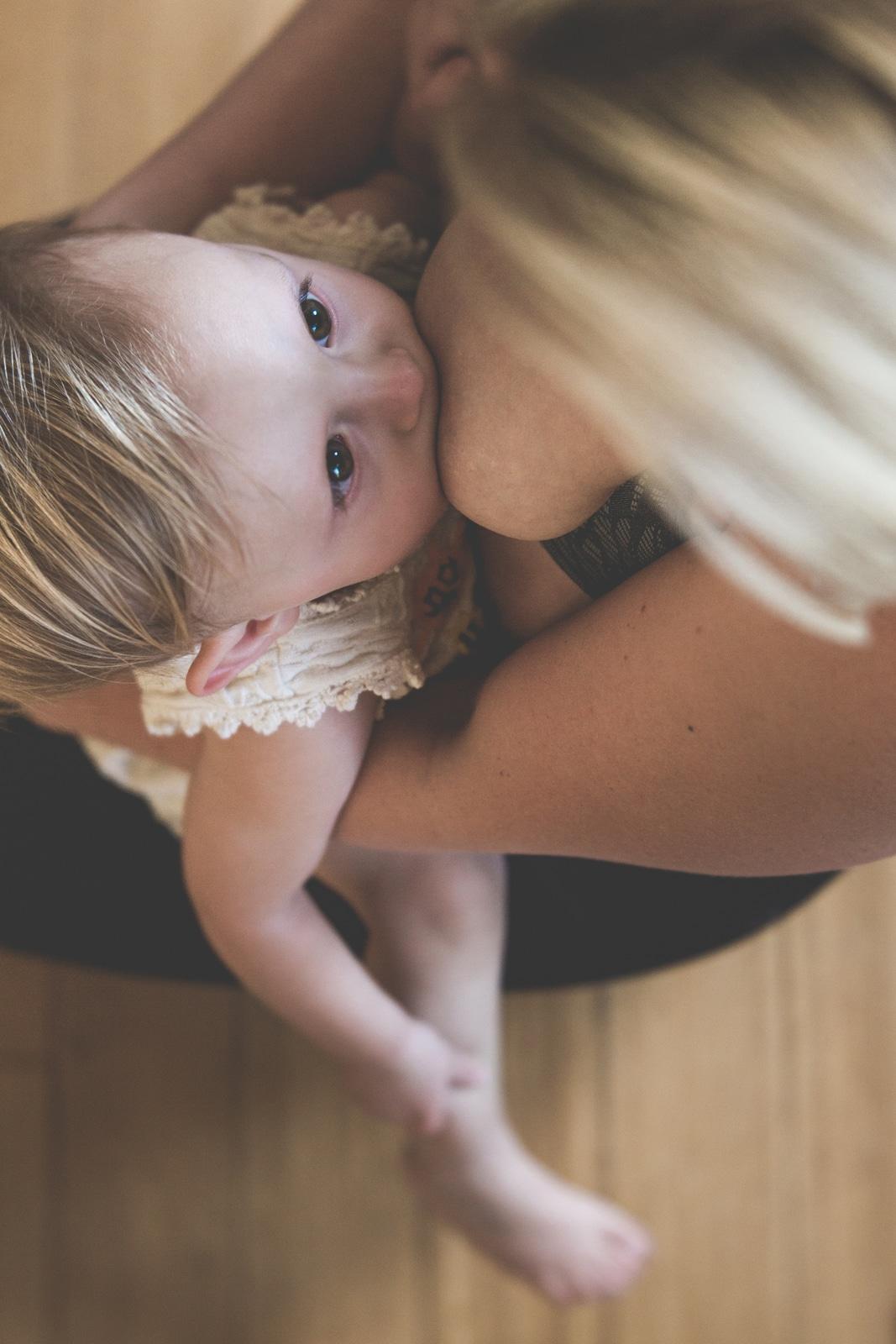 women nursing her daughter