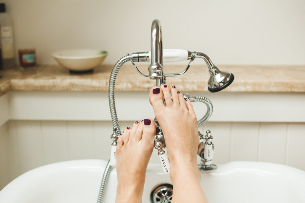 Feet up in bathtub