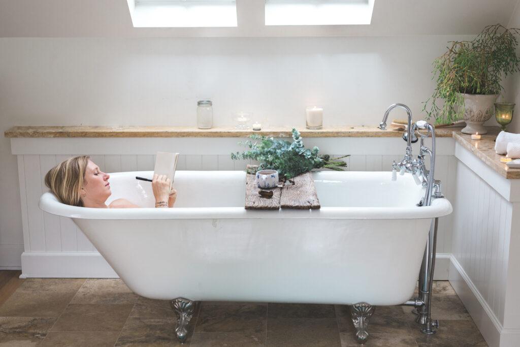 Journaling in relaxing bathtub