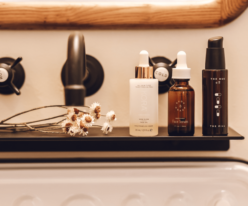 natural skincare products on a bathroom vanity