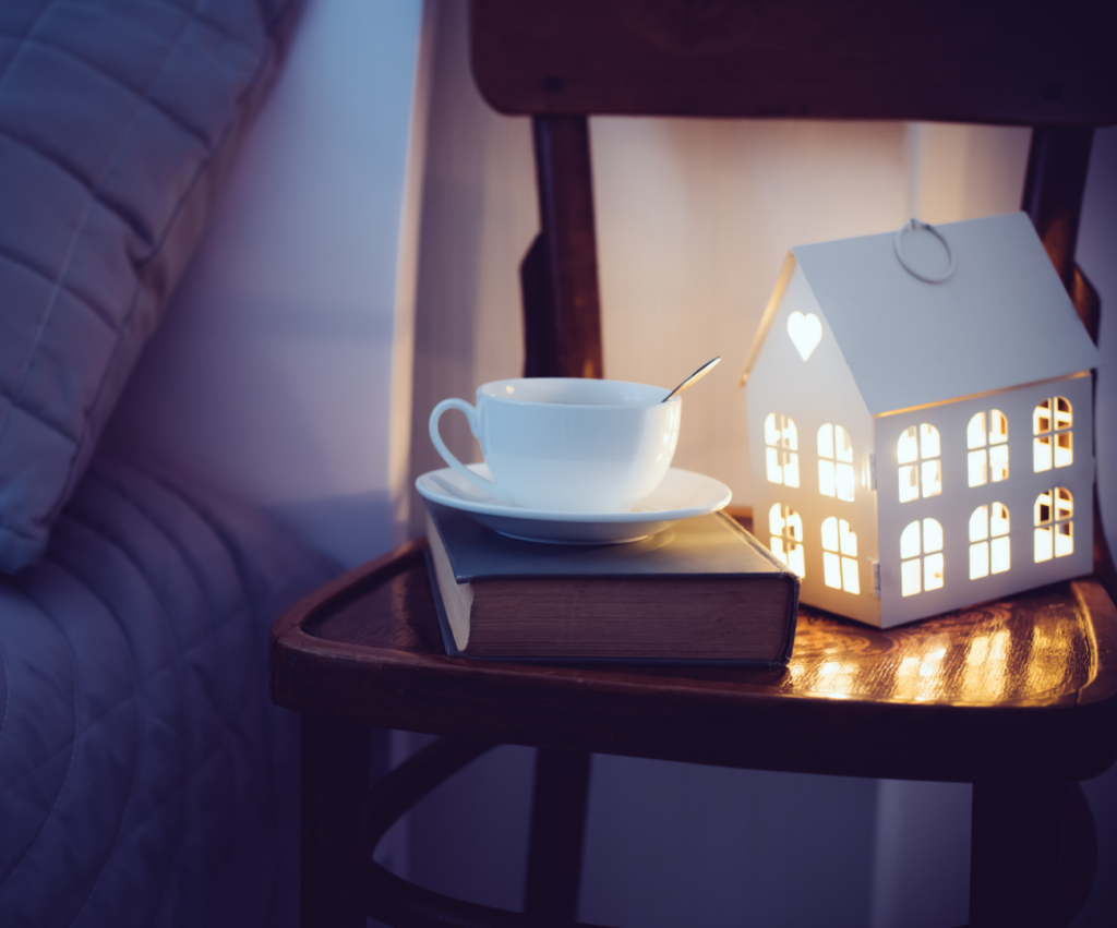 bedside table with nightlight and tea