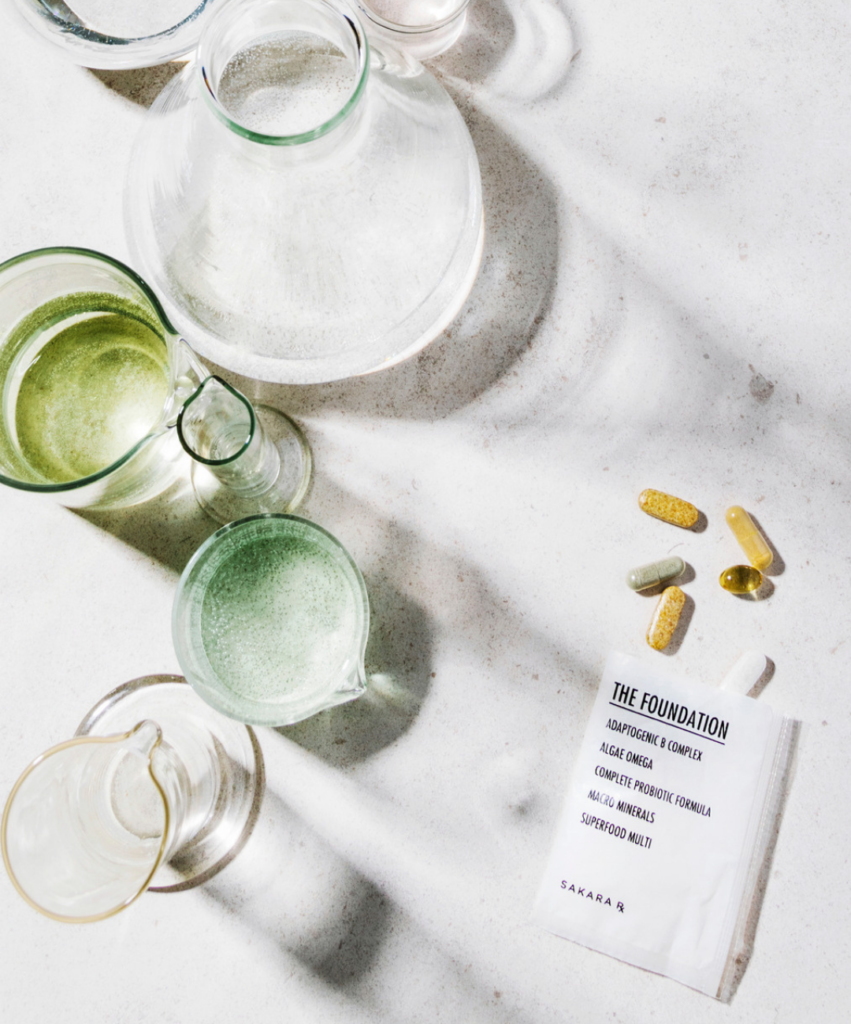 sakara supplement packet with glass vase