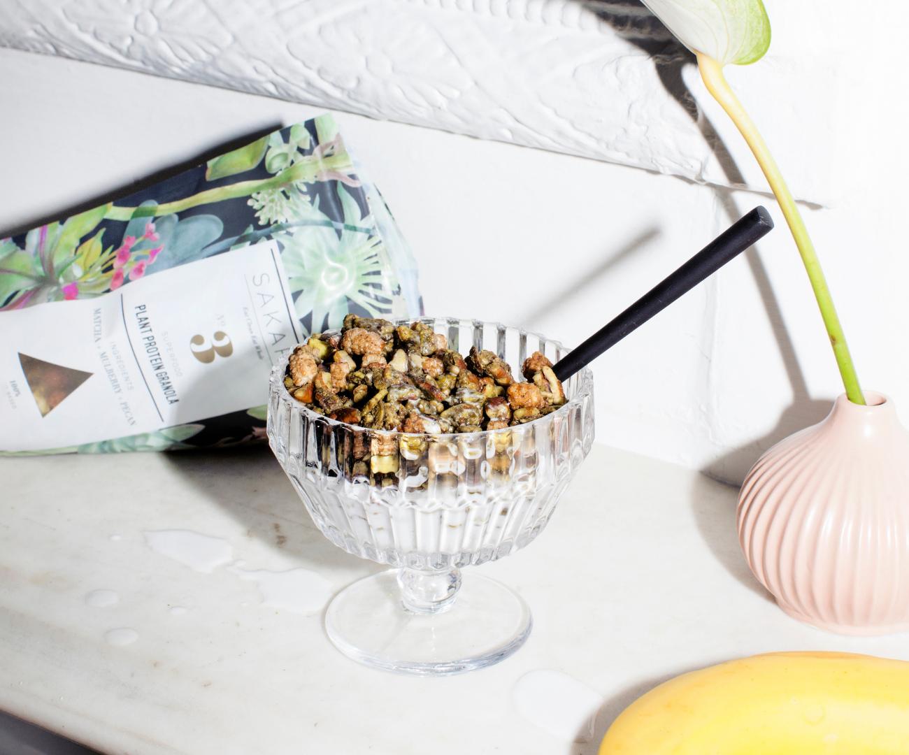 Sakara granola in a glass with milk
