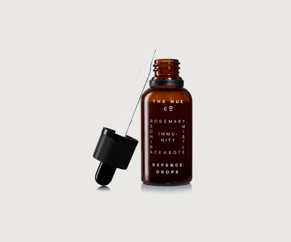 bottle of the nue co. defense drops