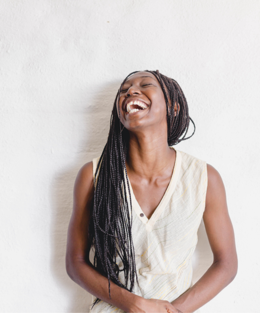 woman on white background laughing at something funny