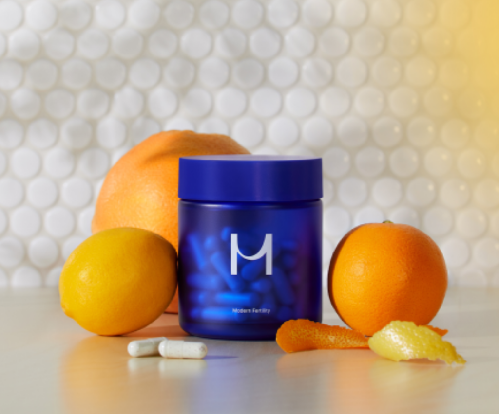 modern fertility prenatal supplements with oranges and lemons in a bright kitchen