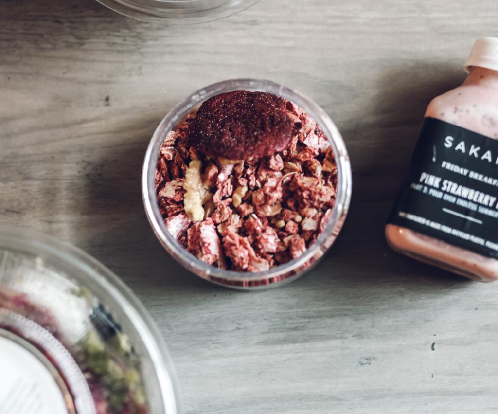closeup of sakara pink mylk and summer granola