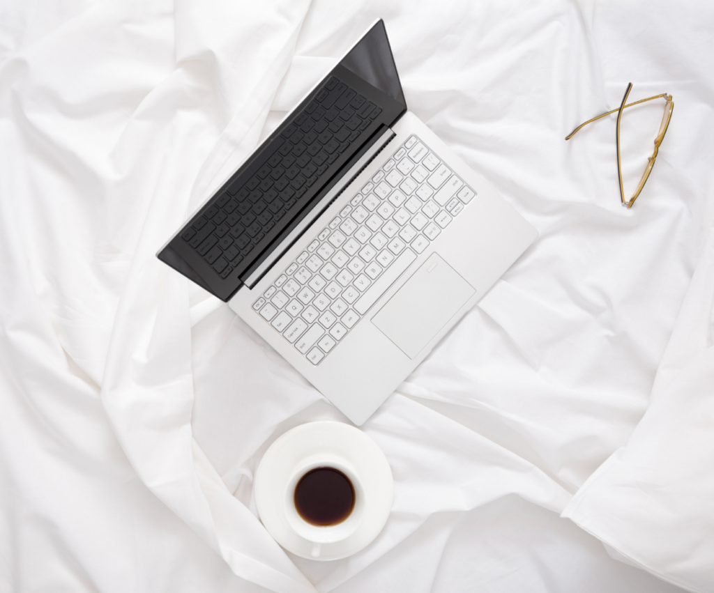 laptop with coffee and glasses